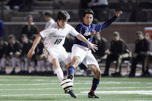 St. Francis' Brookes Treidler, left, and La Salle's Branden Sandoval fight for the ball during a game at St. Francis High School in La Canada on Tuesday, November 27, 2012.