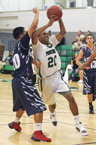 Providence's Marcus LoVett Jr., right drives to the basket during a game against Knights at Providence High School in Burbank on Tuesday, November 27, 2012.