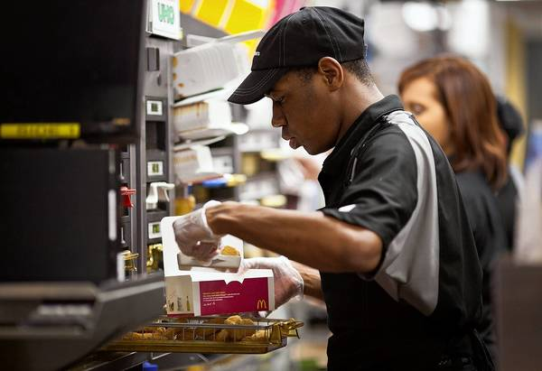 A worker puts together an order at a McDonald's restaurant in New Jersey. One investing expert says that rather than select companies based simply on their high yields, it is more reliable to pick companies such as McDonald's, with a history of growing earnings in addition to rising dividends.
