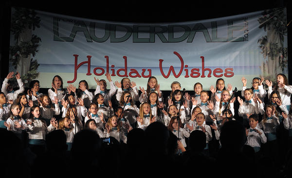 The Joyful Noise choir from Embassy Creek Elementary School, in Cooper City, perform, Tuesday, November 27, 2012, during the 50th annual Christmas on Las Olas event.