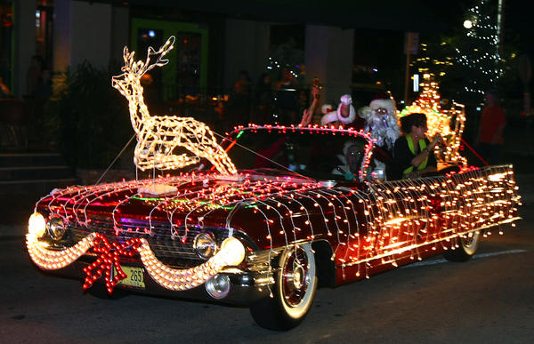 Dennis Manieri drive his 1961 Cadillac convertible festooned with light, a reindeer, and a sound system blasts Christmas tunes and words of wisdom from Santa as they drive down Las Olas Blvd.  They were taking part in SantaCon, a bar-hop procession of locals dressed as Santa Claus who move from the Floridian on Las Olas Boulevard and go bar to bar down to the Briny at Riverfront before arriving at an after-party at the Green Room in Himmarshee. The event benefits Kids in Distress.