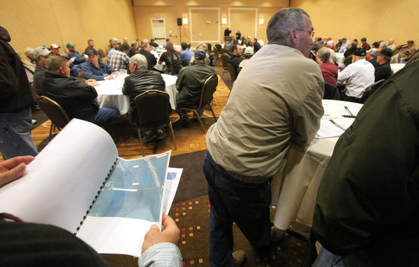 A large crowd of interested buyers were on hand for a land auction Tuesday at the Dakota Event Center. American News Photo by John Davis