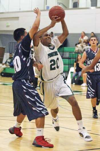 Providence High's Marcus LoVett, Jr drives for a shot  in the Pioneers' opening tournament game.
