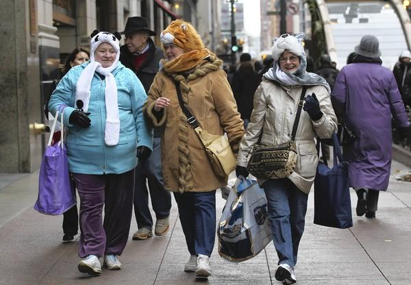 """(Left to right) Lyn Regan, """"Just put 60,"""" homemaker, Springfield, Va.; Dana Malloy, 59, retired, Lorton, Va.;  and Esther Taylor, 71, retired, Springfield, Va.:<br> <br> This trio of East Coast friends acquired their $20 animal hats (with attached scarves and mittens) shopping at the Christkindlmarket. All said they had brought their warmest clothes anticipating a freeze here. """"Isn't Chicago known for cold?"""" Taylor asked.<br> <br> You bet!<br> <br> Regan revealed that she was wearing long johns and had brought boots but said the gym shoes she was wearing were keeping her feet warm enough. Her two friends said they, too, were fine in their sneakers. However, a wardrobe change loomed for the three friends.<br> <br> Said an excited Taylor: """"Tonight we're going to see Donny and Marie."""""""