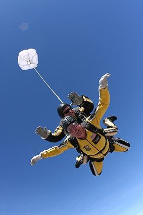 "Showing off his daredevil side by tandem sky-diving with <a class=""taxInlineTagLink"" id=""ORGOV0000001"" title=""United States"" href=""/topic/politics/government/national-government/united-states-ORGOV0000001.topic"">the U.S. Army</a>'s Golden Knights."