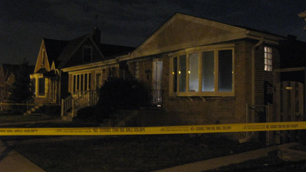 A man in his 40s was found with his throat slashed inside this home, in the 5400 block of North Natoma Avenue in the Union Ridge neighborhood on November 28, 2012.
