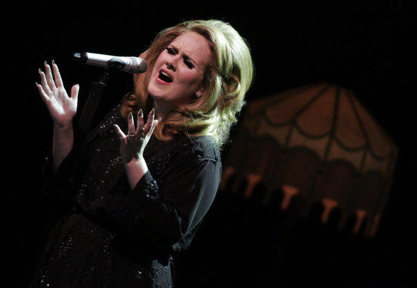 "Adele's ""21"" is one of just eight albums to sell 10 million copies in their first two years of release. Above, Adele performs at L.A.'s Greek Theatre in 2011."