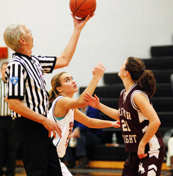 Harbor Springs sophomore center Shallon Grawey (middle) had a game-high 20 points and 10 rebounds in her varsity starting debut Tuesday as the Rams defeated Harbor Light Christian, 69-32, in a non-league contest.