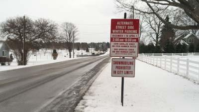 This sign along Sheridan Road near the Petoskey city limit detail's the city's seasonal restrictions for on-street parking.