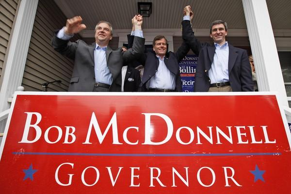 Republican gubernatorial candidate Bob McDonnell, center, and his running mates, Lt. Gov. Bill Bolling, left, and Attorney General candidate Sen. Ken Cuccinelli wave to the crowd during a rally in Richmond, Va., Saturday, Oct. 31, 2009.