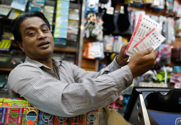 A man sells Powerball lottery tickets in his bodega on the Upper East Side in New York.