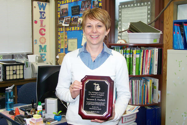 "Central Elementary School first-grade teacher Suzanne Nayback holds the Michigan Council of Teachers of English ""Teacher of the Year"" award."