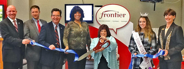Pictured at the ribbon cutting for the remodeled Frontier Communications retail store in Ranson, W.Va., are, from left, Bryan Shaw, Frontier senior marketing specialist; John Reisenweber, executive director of the Jefferson County Development Authority; Paul Espinosa, general manager of Frontier Communications; Diana Rossbach and Kim Mills, Frontier retail sales specialists; Lexi Openshaw, Miss Jefferson County Outstanding Teen; and Heather Morgan McIntyre, executive director of the Jefferson County Chamber of Commerce.