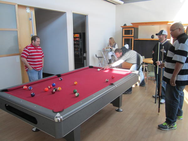 The dedicated game room at CARCHEX includes a big screen TV, pool table and Xbox gaming console. The company also works like cornhole, golf and baseball into their weekly and monthly sales contests.