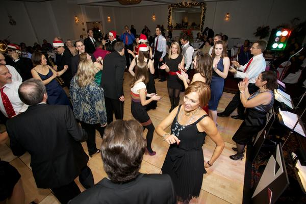 At Engineering Solutions Inc., the annual holiday party is open to all employees and their significant others. Usually held at an Annapolis hotel, there's cocktails dinner and dancing. If people want to stay the night, the company buys breakfast in the morning.