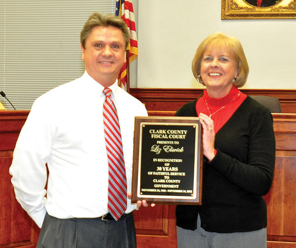 Clark County Judge-Executive Henry Branham took a moment during Tuesday¿s Fiscal Court meeting to present deputy Clark County Judge-Executive Liz Elswick a plaque commemorating her 30 years of service as a county employee.