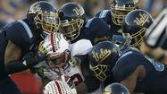 Writers from around the Tribune Co. will predict the winners of the Pac-12 and Big Ten championship games. Check back throughout the day for their responses and join the conversation with a comment of your own.