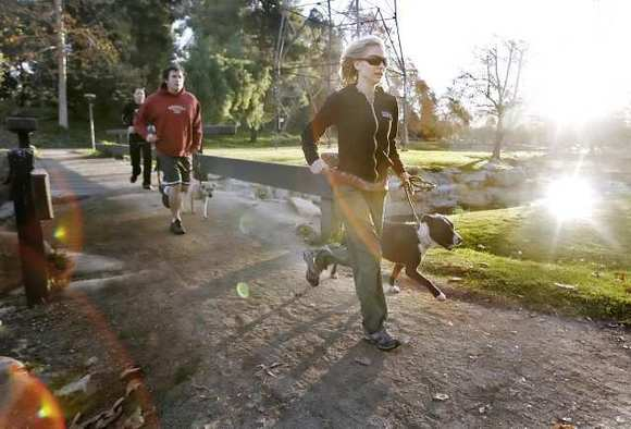 morninParticipants run during a Thank Dog Bootcamp session at Johnny Carson Park in Burbank in 2009.