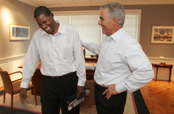 Ronnell Hudson,left,Orlando Sentinel newspaper deliveryman is congratulated for his heroic efforts by Howard Greenberg, Publisher of Orlando Sentinel.