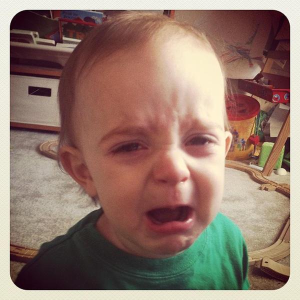 Sad teething boy.