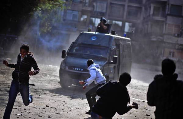 Egyptians clash with security forces near Cairo's Tahrir Square, where President Mohamed Morsi's decree putting himself and the constitutional assembly above judicial oversight has sparked protests.