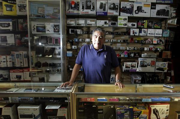 """Any store you opened here on Broadway, it was a gold mine,"" says Cesar Balbuena, a 60-year-old electronics salesman who has worked downtown since 1971. For the last 28 of those years, he's been a fixture at Audio Video Plaza, a glass-walled electronics shop at the edge of the arcade."