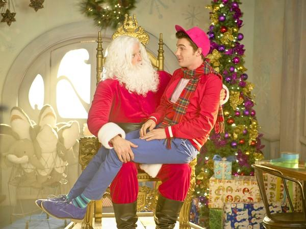 "Timmy (Drake Bell) sits on Santa's (Donavon Stinson) lap in ""A Fairly Odd Christmas."""