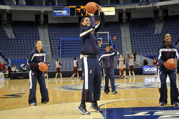 Caroline Doty and Stefanie Dolson switched warmup pants during pregame warmups as the UConn women played Colgate at the XL Center Wednesday night in Hartford.