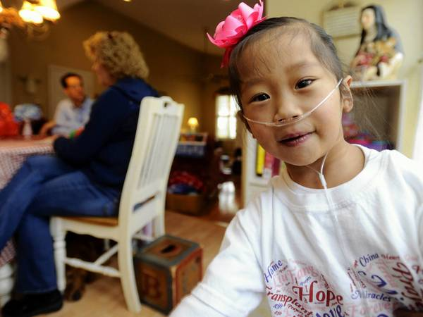 Ann and Ed Bartlinski have adopted five special-needs girls from China. They also have 4 biological children. This is five-year-old Teresa, who needs a heart transplant.