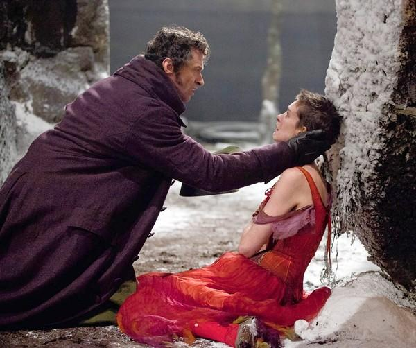 "In ""Les Miserables,"" a sign of Fantine's (Anne Hathaway) fall is her red dress."