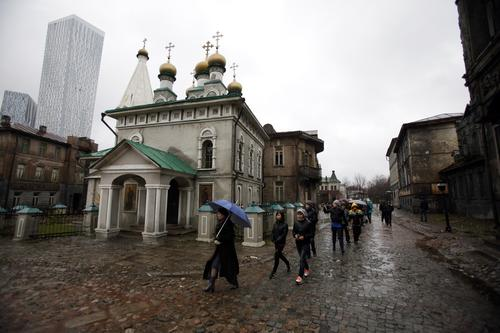 Schoolchildren walk the old Moscow movie-set scenery as part of the tour of the Mosfilm Studios in downtown Moscow.