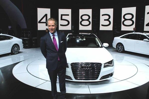 Scott Keogh, president of Audi of America, stands in front of several Audi diesel models the company introduced for the U.S. at the 2012 Los Angeles Auto Show.