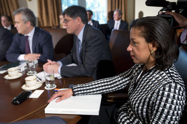 U.N. Ambassador Susan Rice listens, at right, as President Barack Obama speaks before a meeting with his cabinet at the White House in Washington.