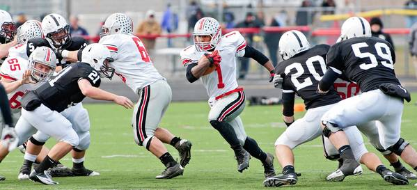 Parkland running back Eli Redmond (1) follows his blockers upfield against Delaware Valley during their District 2-11 4A sub-regional football game on November 24, 2012.