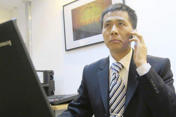 Zhu Ruifeng, who runs a Chinese website exposing official corruption, fields telephone calls in Beijing after his latest expose.