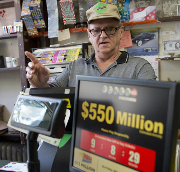 Deli owner Dave Sanders Sr. waits on Powerball hopeful winners as they  buy tickets at Lump's Deli in Bethlehem on Wednesday.