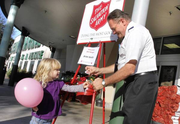 Brian Smith thanks 3-year-old Kenzie Morrison for her donation to the Salvation Army outside Publix in Orlando's College Park neighborhood.