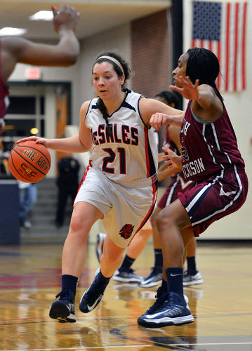DeSales' Megan Gallagher (21) looks to dribble pass Fairleigh Dickinson's Kyra Dayon (15) during a women's basketball game at DeSales University on Wednesday evening.