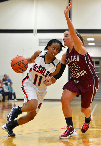 DeSales' Alexiah Grant (11) dribbles against Fairleigh Dickinson's Leigh-Ann Lively (25) during a women's basketball game at DeSales University on Wednesday evening.