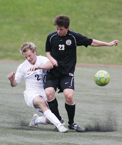 Flintridge Prep's Kurt Kozacik gets in front of Grace Brethren's Coby Larson to clear the ball in the second half in a non-league boys soccer match at the Glendale Sports Complex on Wednesday, November 28, 2012.