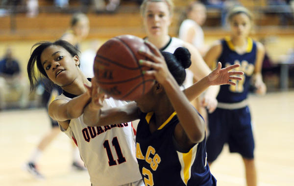 Alexis Heath, of Friends School, left, tries to steal the ball from Jaida Molden, of Annapolis Area Christian.