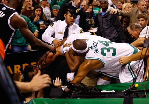 Celtics forward Paul Pierce and a Boston Garden security guard try to separate Nets forward Kris Humphries and Boston guard Rajon Rondo as they scuffled during the second quarter of their game Wednesday night.