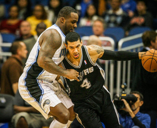 Magic forward Glen Davis (11) guards San Antonio's Danny Green (4) during second quarter action of a game against the San Antonio Spurs at Amway Center in Orlando, Fla. on Wednesday November 28, 2012.