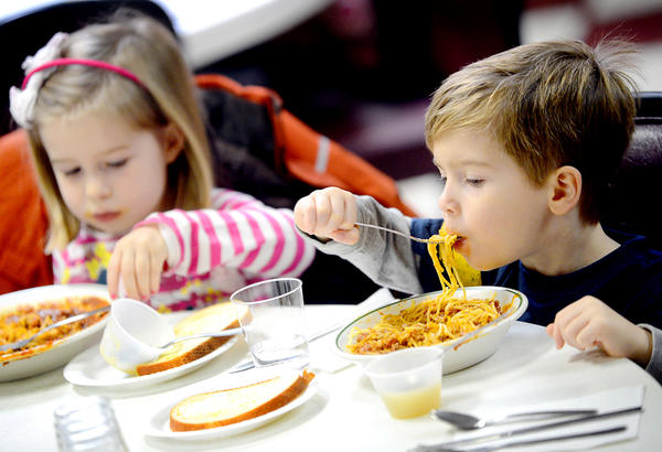 Will Burgum, 4, and his twin sister, Ava, of Chambersburg, Pa., eat spaghetti Wednesday night at the Marine Corps League in Chambersburg.