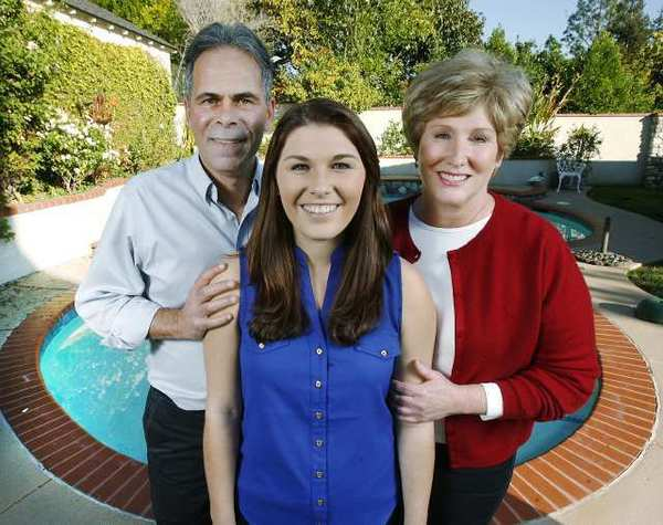 Rose Princess Madison Teodo, with her parents Mark and Cinda, at their home in La Canada Flintridge.