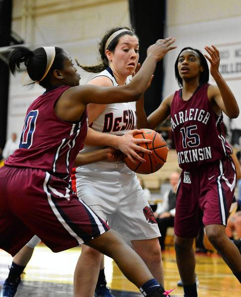 DeSales' Megan Gallagher (21) is defended by Fairleigh Dickinson's Jalessa Lewis (0) and Kyra Dayon. Gallagher had 16 points, six rebounds and five assists in the game.