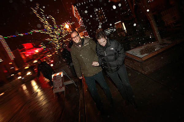 "During a steady snowfall, Nicholas McCarthy and his wife Alexandra McCarthy make their way up Main Street in Park City, UT., toward the Egyptian Theatre, for the premier of his featurelength horror film ""The Pact."""