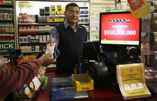 Gandhi Amrutlal sells a Powerball lottery ticket at his market in Chicago.
