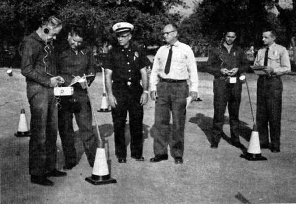 La Canada firefighters learn how to read the measure of radioactive fall-out during exercises held in the Arroyo Seco near JPL, in the weeks following the 1962 Cuban missile crisis.