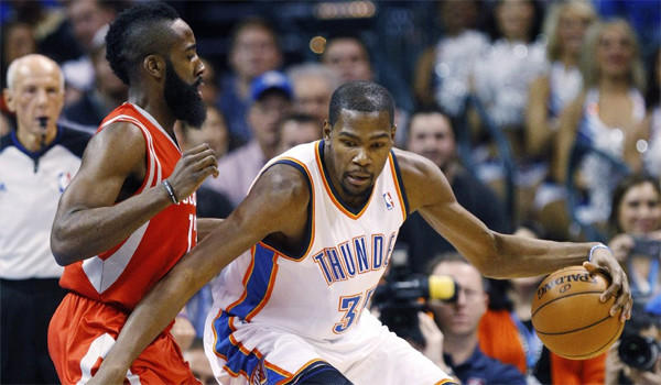 Oklahoma City Thunder forward Kevin Durant drives around James Harden during the Houston Rockets guard's first trip to Oklahoma City since the team traded him in October.